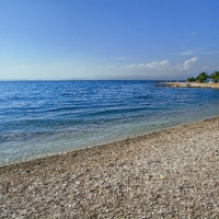 Beach in front of Velaris with Maestral Travel Agency